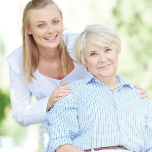 nurse and resident portraying assisted living