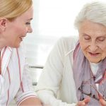 nurse providing memory care services with resident